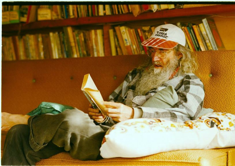 The 2004 photo of me reading to two others, in the furnished end of our barn in the Kauaeranga Valley, New Zealand
